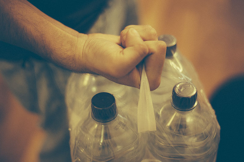 survivalist prepper stockpiling bottled water
